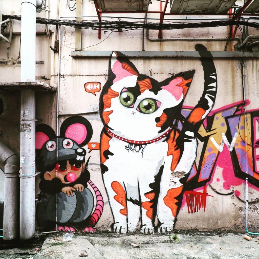 cat graffiti across the street